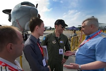 U.S. Air Force Col. Marc Caudill, the U.S Pacific Command mission commander for the U.S. forces supporting the 2012 Singapore Airshow, speaks to Commander-in-Chief of the Russian Air Force Col. Gen. Alexander Zelin before touring the E-3 Sentry on Feb. 15, 2012, in Changi, Singapore. While being the third largest trade show in the world, the biennial Singapore Airshow also provides the opportunity for airmen from many different countries to interact and improve foreign relations. (U.S. Air Force photo/Tech. Sgt. Michael R. Holzworth)