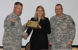 SAVANNAH, Ga. — Maj. Gen. Todd Semonite, Commander of the U.S. Army Corps of Engineers South Atlantic Division, presents Beth Williams with the prestigious Connolly Award at the Savannah E-Week Technical Training Conference, Feb. 22, 2012. Right: Col. Jeff Hall, USACE Savannah District Commander and SAME Savannah Post President.