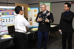 GEORGIA — Col. Jeff Hall, commander of the U.S. Army Corps of Engineers Savannah District, and Jimmy Luo, an electrical engineer at the Corps' Fort Stewart field office, speak with a student about his science project at the 2012 Georgia Tech Regional Science and Engineering Fair, Feb. 16, 2012.
