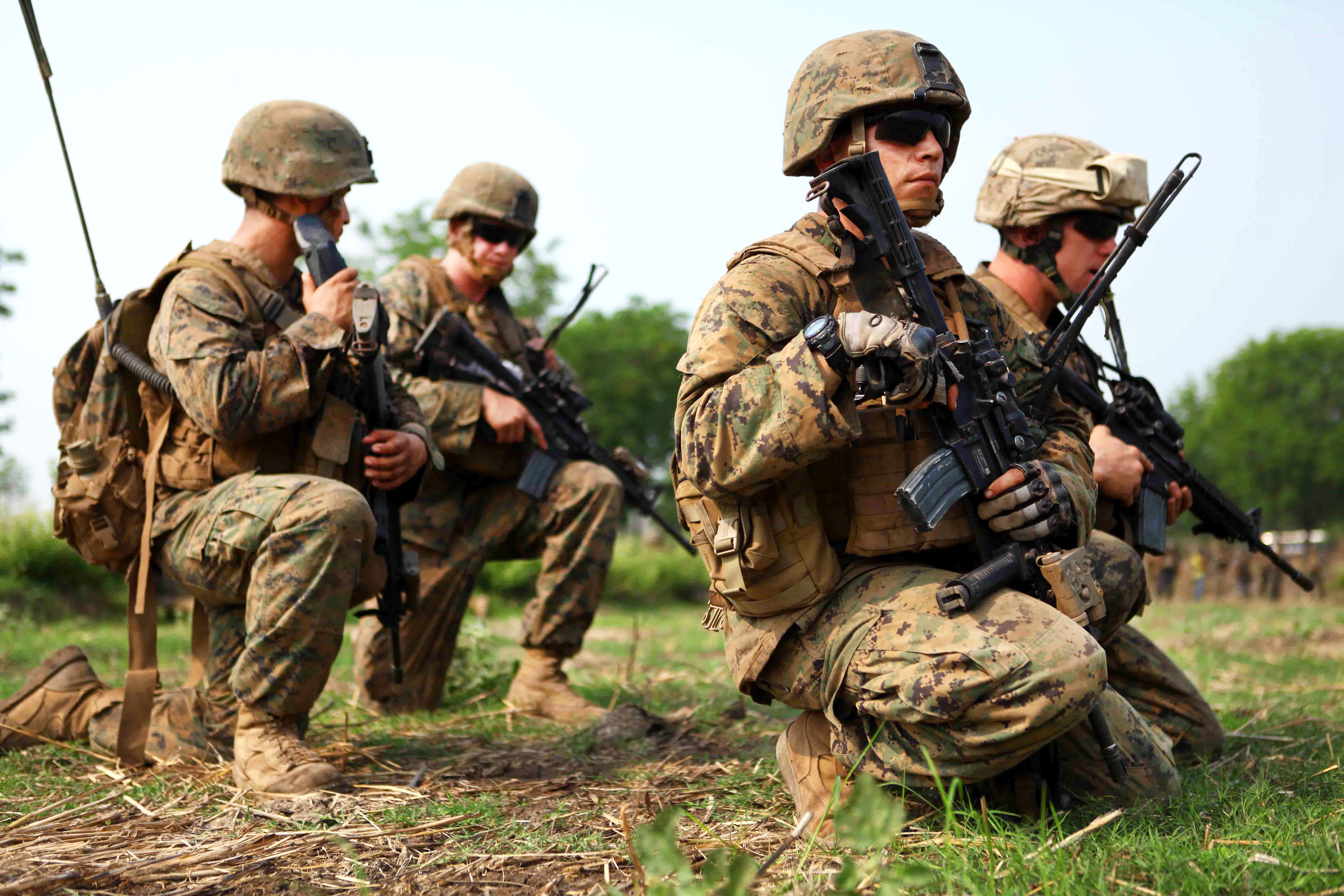 bdcc3034eb0 U.S. Marines hold an assault position with Thai Marines during a bilateral  combined arms live-fire ...