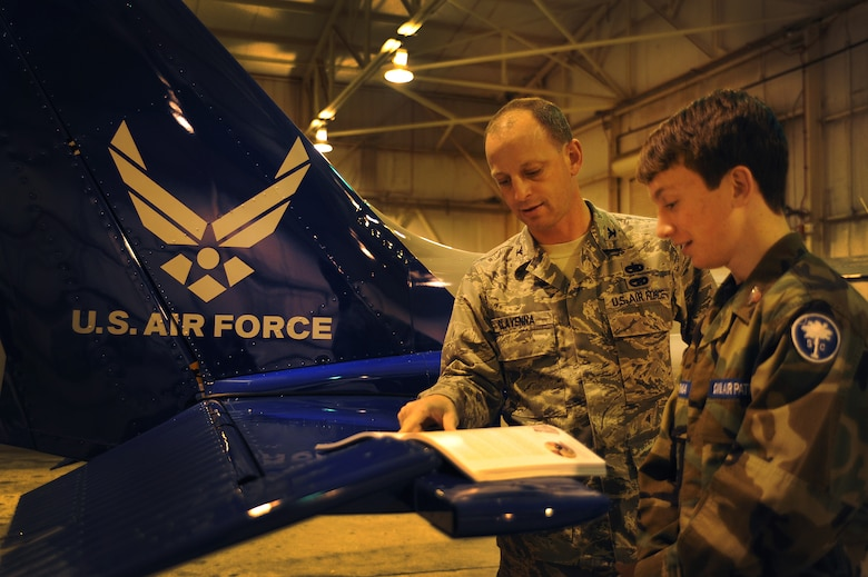 Cadet Airmen Jack Clavenna and father Col. James Clavenna read the Civil Air Patrol Leadership Manual to  at the Coastal Charleston Composite Squadron, Joint Base Charleston - Air Base Feb. 13. Clavenna takes his son to weekly CAP meetings. The Civil Air Patrol has one of the largest fleets of single-engine aircraft in the world, with more than 550 aircraft nationwide. Clavenna is the commander of the 437th Maintenance Group, 437th Airlift Wing. Jack has been in CAP for nearly a year. (U.S. Air Force photo/Airman 1st Class Ashlee Galloway)