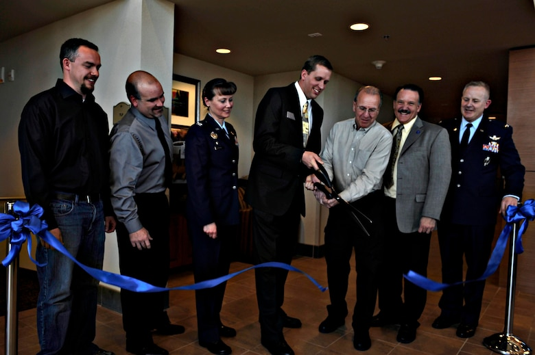 BUCKLEY AIR FORCE BASE, Colo.--  Colonel Daniel Dant, 460th Space Wing commander, right, Col. Deirdre Mahon, 460th Mission Support Group commander, left, join the rest of the officiating party in the Rocky Mountain Lodge ribbon cutting, Feb. 24, 2011.  The new lodge has 150 rooms, 120 of which are for visitors and 30 rooms for transient families leaving or reporting into Buckley. (U.S. Air Force photo by Airman 1st Class Riley Johnson)
