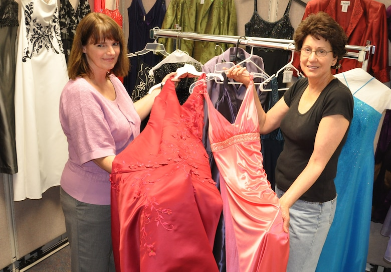 LACKLAND AIR FORCE BASE, Texas -- Linda Slater, Cinderella's Closet volunteer, shows customer Dianne Stewart, right, some of the dresses available for loan to military and family members here Feb. 24. Dresses for dances, other formal occasions and weddings are available with the only requirement to return items dry cleaned within 10 days. (U.S. Air Force photo by Lt. Col. Cynthia East)