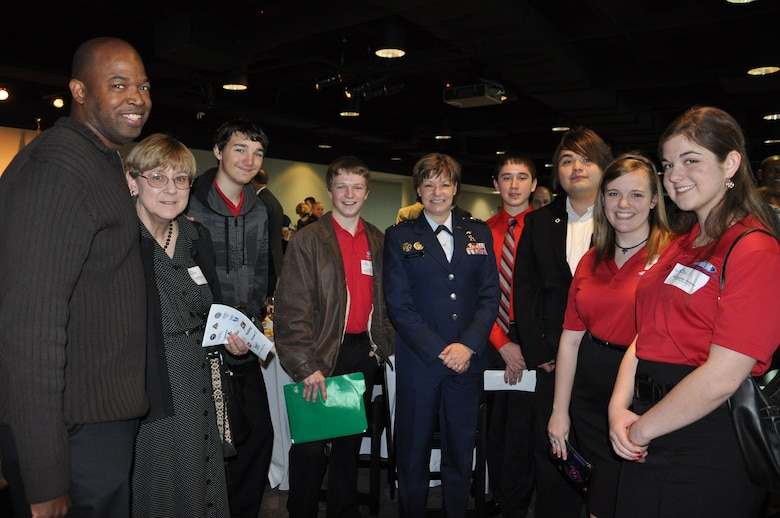 SAN ANTONIO -- Members of the CyberPatriot team from the Information Technology Security Academy stop for a picture with Maj. Gen. Suzanne Vautrinot, 24th Air Force commander, after attending the 2nd Annual Mayor's Cyber Cup at the Venues at Valero here Feb. 18. The Mayor's Cyber Cup luncheon recognized the high school team in San Antonio that has performed the best in the national CyberPatriot competition as well as the thirty-six high school teams in San Antonio that have participated in the competition. (U.S. Air Force photo by Lt. Col. Cynthia East)
