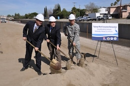 LOS ANGELES, Calif. — Mark Pestrella, Los Angeles County Public Works Deputy Director, Zev Yaroslavsky, Los Angeles County Supervisor, and Col. Mark Toy, U.S. Army Corps of Engineers Los Angeles district commander (left to right), ceremonially turn dirt Feb. 22 for the start of the $7 million Tujunga Wash Ecosystem Restoration project that will extend greening along the sides of a 3/4-mile stretch of concrete channel in the San Fernando Valley that carries runoff from Hansen Dam to the Los Angeles River.