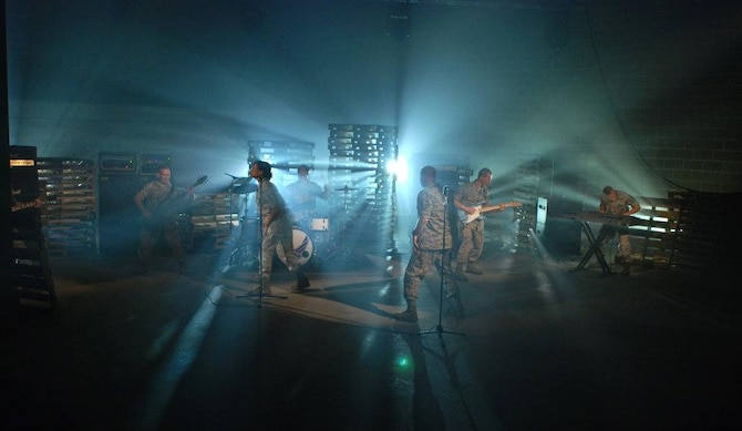 "Max Impact, the premier rock band of the United States Air Force, performs during the production of their ""Send Me"" video.  U.S. Air Force photo by Master Sgt. Bob Kamholz."