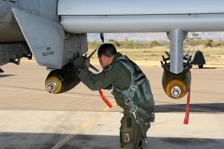 Lt. Col. Marty Dahlem, an A-10C Thunderbolt II pilot with the 188th Fighter Wing, left, conducts a preflight inspection prior to takeoff during a deployment to Davis-Monthan Air Force Base, Ariz., Feb. 21 to participate in Operation Snowbird in preparation for the Flying Razorbacks' deployment to Afghanistan this summer. (National Guard photo by Senior Master Sgt. Dennis Brambl/188th Fighter Wing Public Affairs)