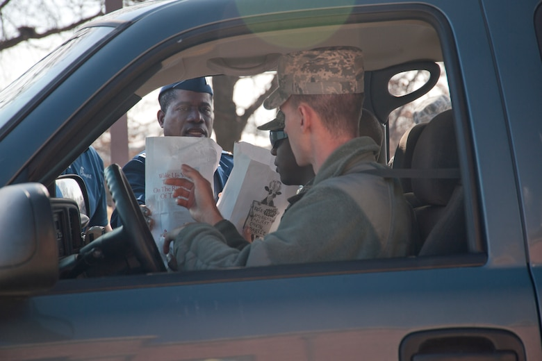 Chaplain (Capt.) Denis Geue, 11th Wing chaplain, distributes Chick-fil-a meals 