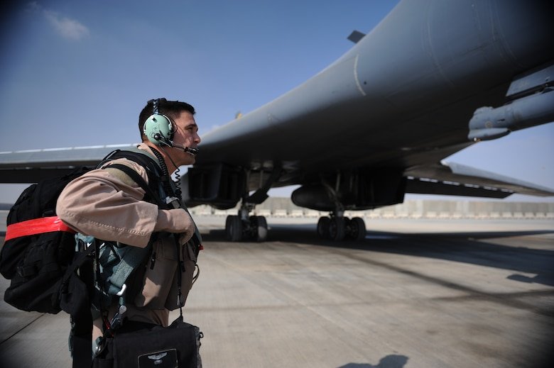 "Lt. Col. Alejandro Gomez, 9th Expeditionary Bomb Squadron mission team lead and native of Aledo, Texas, walks towards a B-1 prior to take-off here Feb. 26, 2012. The B-1, or ""Bone"" as it is affectionately known, was initially developed in the 1970s as a strategic bomber and as a replacement to the B-52 Stratofortress. The B-1's historic 10,000th combat mission was performed in support of ground forces in Afghanistan. (U.S. Air Force photo/Staff Sgt. Nathanael Callon)"
