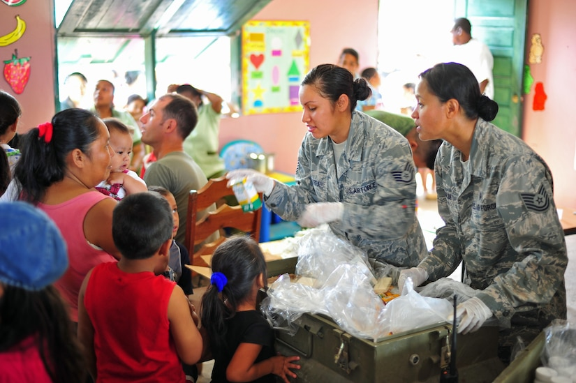 BELLA VISTA, Belize – U.S. Air Force Technical Sgt. Corazon Palle and Staff Sgt. Deanna Sierra, Medical Element medical technicians, distribute vitamins, de-wormer and sanitation supplies after Bella Vista community members complete the preventive medicine course during a joint medical readiness training exercise here Feb. 28. Members from the Belize Ministry of Health, the Belizean military and Joint Task Force-Bravo, Soto Cano Air Base, Honduras provided medical services to approximately 620 members of the local area Feb. 28.