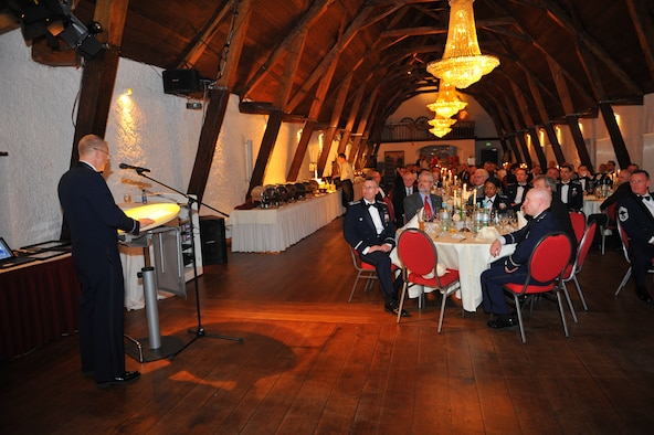 NIEDERWEIS, Germany – Col. Chris Weggeman, 52nd Fighter Wing commander, speaks to wing leadership and German civic leaders about the importance of building partnerships during a 52nd FW Honorary Commanders Banquet at Niederweis Castle here Feb. 24. The banquet is held to ceremoniously induct German civic leaders into the honorary commander program through a tradition of passing the 52nd FW guidon to the new honored commander. The program allows squadron, group and wing commanders to bolster and sustain partnerships with local leaders by working alongside one another to talk about and resolve community issues. (U.S. Air Force photo by Airman 1st Class Dillon Davis/Released)