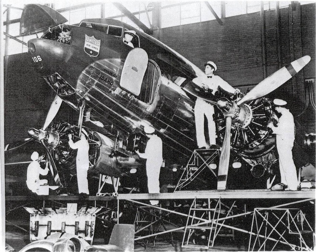 Mechanics work diligently on a Untied Airlines aircraft in Cheyenne, Wyo. (Image courtesty of Wyoming State Archives)