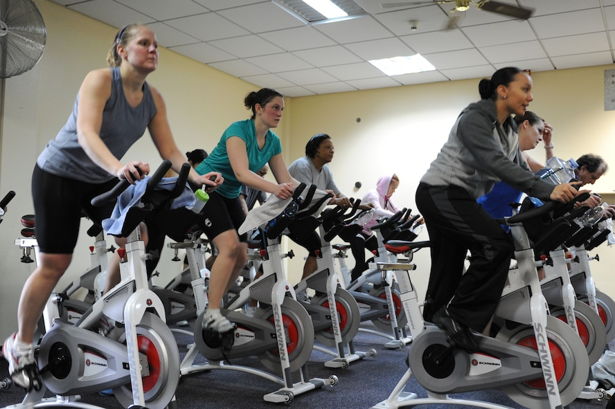 SPANGDAHLEM AIR BASE, Germany – Base members participate in a spin-a-thon at the Skelton Memorial Fitness Center here Feb. 25. The spin-a-thon was a period of high-intensity indoor cycling that allowed members to challenge their cardio fitness with an option of signing up for one to three hours of spinning. Participants were guided by instructors through different workout phases with a variety of up-beat music. Spin class is one way to get a workout that burns calories and keeps bodies in shape offered at the fitness center. (U.S. Air Force photo by Senior Airman Christopher Toon/Released)