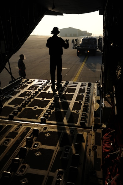 SPANGDAHLEM AIR BASE, Germany – An Airman guides a K-loader to the ramp of a C-130 Hercules here Feb. 27 to load cargo for a flight to Turkey in support of Anatolian Falcon 2012, a weapons training deployment that includes interdiction, attack, air superiority, defense suppression, airlift, air refueling and reconnaissance. More than 250 Airmen from the 52nd Fighter Wing will participate in the exercise hosted at Turkish air force's Konya Air Base. The U.S. and Turkish air forces will work together and improve both nations' combat readiness through tactical training during the exercise. (U.S. Air Force photo by Airman 1st Class Matthew B. Fredericks/Released)