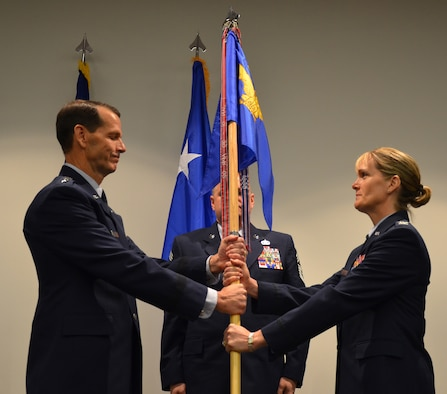Col. Dawne Deskins receives the guidon from Lt. Gen. Stanley E. Clarke, Commander, CONR/1st Air Force (AFNORTH) during EADS change of command ceremony on Feb. 17.