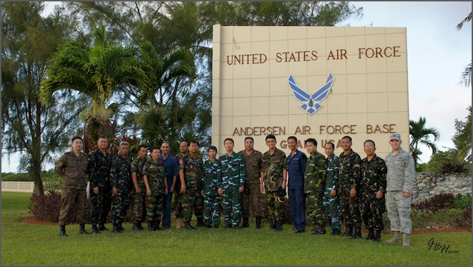 Delegates from the Philippine Air Force, Royal Cambodian Air Force, Royal Lao Air Force, Royal Thai Air Force, Mongolian Air Force and Vietnam People's Air Force pose outside Andersen Air Force Base. As part of U.S. Pacific Command's Theater Security Cooperation Program, a multilateral subject-matter expert exchange co-hosted by senior civil engineer and security forces personnel from Headquarters 13th Air Force concluded here Feb. 23. (U.S. Air Force photo/ Capt. Grant Harwell)