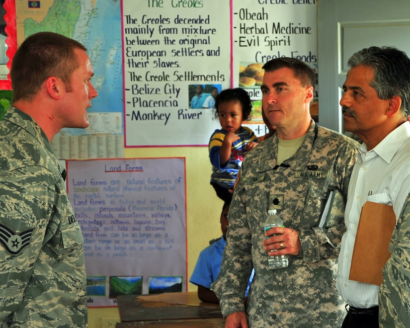 INDEPENDENCE, Belize – U.S. Air Force Staff Sgt. Thomas Delperdang, Medical Element pharmacy NCOIC, explains the pharmacy procedures to Ambassador Vinai Thummalapally, U.S. Ambassador to Belize, and Lt. Col. Lynn, Military Liaison Office, during their site visit to the joint medical readiness training exercise here Feb. 29. (U.S. Air Force photo/Staff Sgt. Bryan Franks)