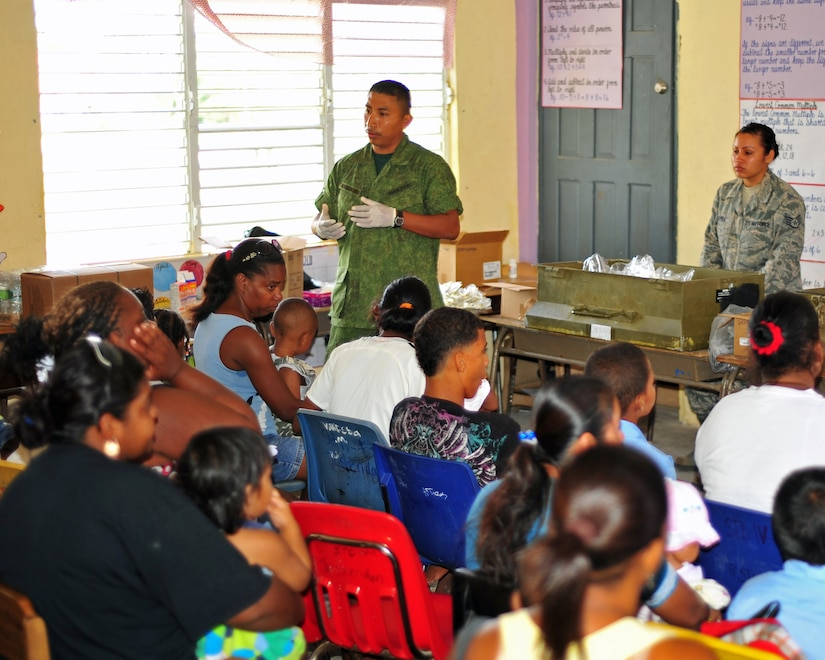 INDEPENDENCE, Belize – Belize Defence Force Lance Cpl. Richardo Ayala, conducts a preventive medicine course for Independence community members prior to them seeing the medical care providers during a joint medical readiness training exercise here Feb. 29. Members from the Belize Ministries of Health and Education, Belize Defence Force and Joint Task Force-Bravo, Soto Cano Air Base, Honduras provided medical services to approximately 460 members of the local area Feb. 29. (U.S. Air Force photo/Staff Sgt. Bryan Franks)