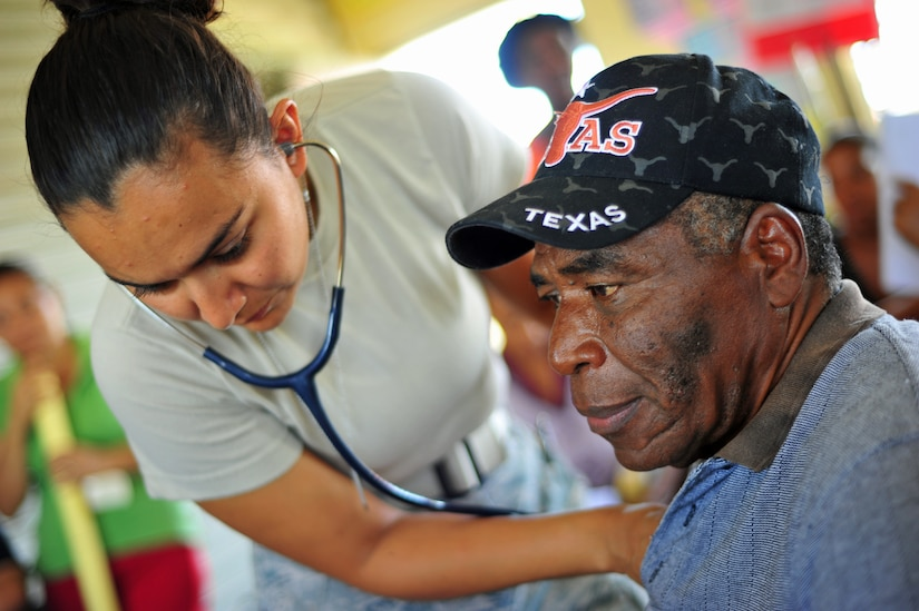 INDEPENDENCE, Belize – U.S. Air Force 1st Lt. Arlene Prada, Medical Element nurse, conducts a screening for a Belizean man during the final day of a joint medical readiness training exercise here Feb. 29. In 2011, Joint Task Force Bravo, Soto Cano Air Base, Honduras provided general medical care to 14,401 patients and dental care to 1,061 patients for a total of 15,462 individuals receiving much-needed assistance. (U.S. Air Force photo/Staff Sgt. Bryan Franks)