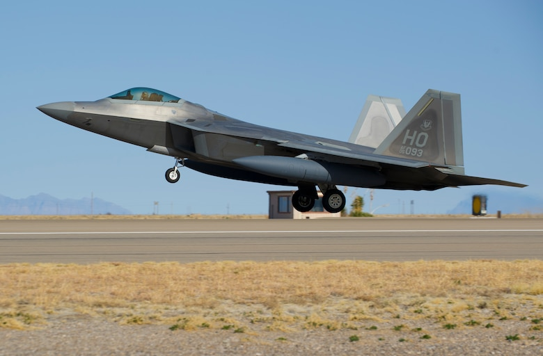 HOLLOMAN AIR FORCE BASE, N.M. – An F-22 Raptor begins take-off from the runway here Feb. 29. The launching of 15 consecutive F-22 Raptors marked the culmination of a Phase One Operational Readiness Exercise at Holloman.  (U.S. Air Force photo by Airman 1st Class Daniel E. Liddicoet/Released)
