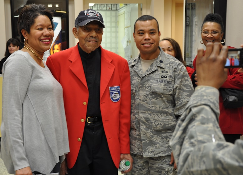 "Tuskegee Airmen Tech. Sgt. (Ret.) Boyd Taylor (center) poses for a photo with Lt. Col. James Lawrence and his wife Khim, at the base theater at Beale Air Force Base Calif., Feb. 24, 2012. Tuskegee Airmen from a local TA inc. chapter showed a screening of the movie ""Red Tails"" in honor of the base's celebration of African-American/Black History Month. (U.S. Air Force photo by Staff Sgt. Robert M. Trujillo/Released)"