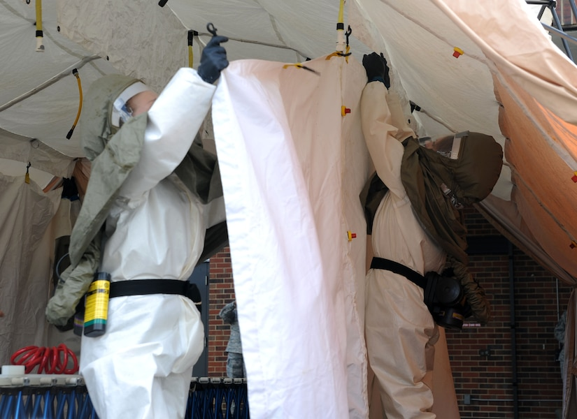 Airmen participate in the In Place Patient Decontamination training at Joint Base Charleston - Air Base Feb. 23. The training is designed to prepare Airmen to provide care during a chemical, biological, radiological or nuclear catastrophe. The team was required to be fully operational in 20 minutes in order to pass the training. The 628th Medical Group team was able to accomplish the task in 12 minutes. (U.S. Air Force photo/Airman 1st Class Ashlee Galloway)