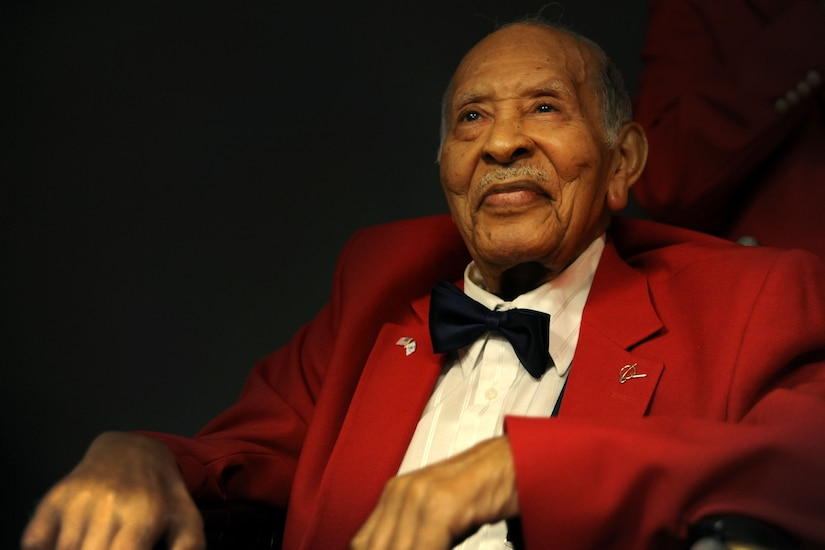 Tuskegee Airman Edward Gibson smiles for the camera at Joint Base Charleston - Air Base Feb. 16. Gibson served in the Army Air Corps as a bombardier-navigator and logged 2,300 flight hours.  (U.S. Air Force photo/Airman 1st Class Ashlee Galloway)