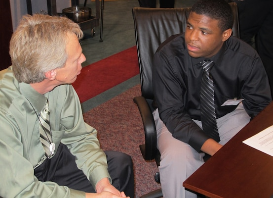 HUTSVILLE, Alabama — Bryant Marshburn (left), U.S. Army Corps of Engineers Huntsville Center engineering directorate, discusses education and career planning with Alabama A & M student Michael Wallace during an informal mentoring session Feb. 24, 2012.