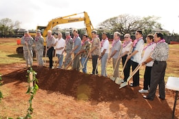 SCHOFIELD BARRACKS, HI - U.S. Army and Absher Construction officials man the Hawaiian o'o sticks and ceremonial gold shovels prior to the official ground breaking for the new 228 personnel UEPH on Montague Street.  Army personnel participating in the official groundbreaking were: Lt. Col. David Hurley, 25th ID Division Engineer (left), Lt. Col. Douglas Guttormsen, commander U.S. Army Corps of Engineers Honolulu District (second from left),  and Col. Douglas Mulbury, commander, USAG-HI (fifth from left).