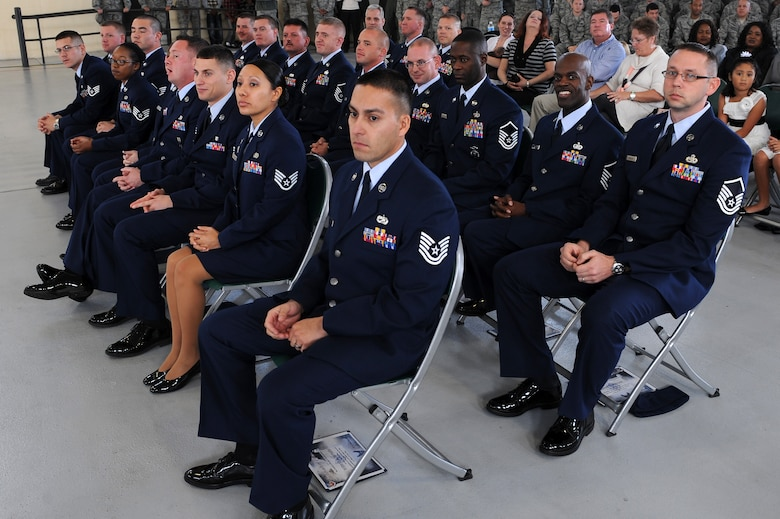 Moody Air Force Base's newest promotees sit at the conclusion of a promotion ceremony Dec. 30, 2011. Family, friends and co-workers attended to congratulate the Airmen. (U.S. Air Force photo by Staff Sgt. Ciara Wymbs/Released)