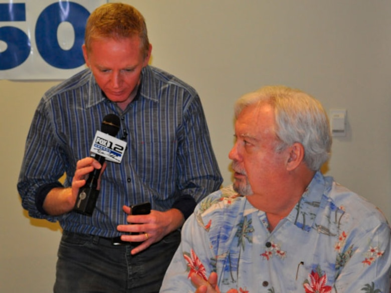 "Fox 12's ""Good Day Oregon"" weatherman Andy Carson and KPAM radio host Bob Miller conduct a live television interview about ""Operation Santa Claus."" (photo provided by 142 Security Forces Squadron)"