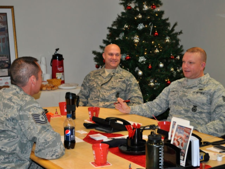 TSgt Jason Schroeder, TSgt Shawn Potter, SSgt Kylan Olsen , 142 Security Forces Squadron taking a moment to enjoy coffee prior to the phone lines opening up. (photo provided by 142 Security Forces Squadron)