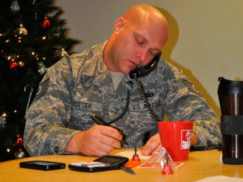 Technical Sergeant Shawn Potter, 142 Security Forces Squadron taking a donation from a generous caller. (photo provided by 142 Security Forces Squadron)