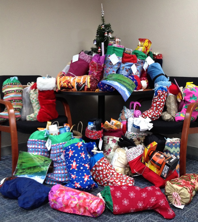 Some of the 75 Christmas Stockings that were filled by members of the 142nd Fighter Wing members and were donated to needy families in the Portland area during the holiday season. (photo provided by the 142nd Fighter Wing Family Programs)