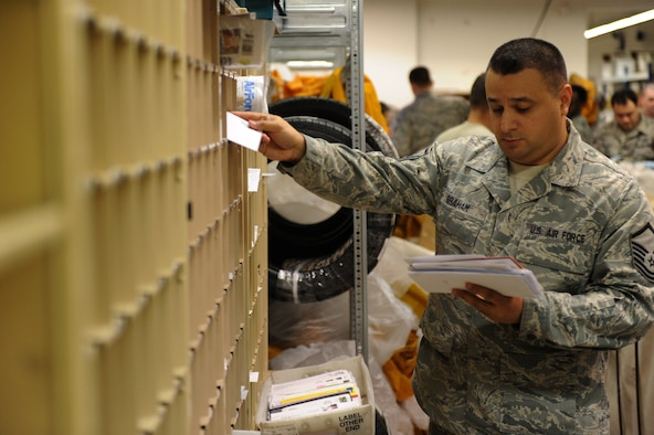 SPANGDAHLEM AIR BASE, Germany – Master Sgt. Melvin Graham, 52nd Communication Squadron post master, sorts mail to be picked up at the Spangdahlem Post Office here Jan. 2. The post office processed 423,000 pounds of inbound mail from Nov. 1 to Dec. 31 to ensure Saber Airmen and their families received their packages for the holiday season. (U.S. Air Force photo/Airman 1st Class Matthew B. Fredericks)