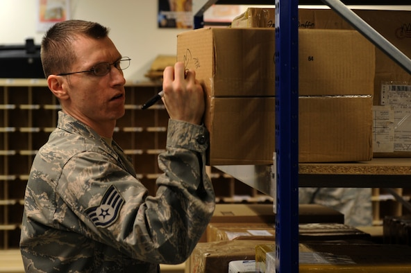 SPANGDAHLEM AIR BASE, Germany – Staff Sgt. Timothy Byrd, 52nd Communication Squadron postal clerk, marks a package with a P.O. Box number to be stored until picked up at the Spangdahlem Post Office here Jan. 2. The post office processed 423,000 pounds of inbound mail from Nov. 1 to Dec. 31 to ensure Saber Airmen and their families received their packages for the holiday season. (U.S. Air Force photo/Airman 1st Class Matthew B. Fredericks)