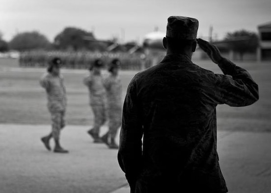 Col. Sal Nodjomian, the 96th Air Base Wing commander, salutes the new Airmen at the basic military training graduation parade at Lackland Air Force Base, Texas.  (Courtesy photo)