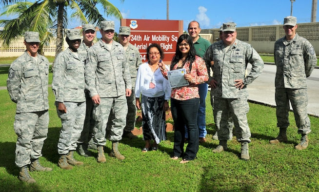 ANDERSEN AIR FORCE BASE, Guam—Yolonda Flores, Aerial Port Flight secretary, was awarded Team Andersen's Best, Dec. 29. Andersen's Best is a recognition program which highlights a top performer from the 36th Wing. Each week, supervisors nominate a member of their team for outstanding performance and the wing commander presents the selected Airman/Civilian with an award. (U.S. Air Force photo by Senior Airman Benjamin Wiseman/Released)