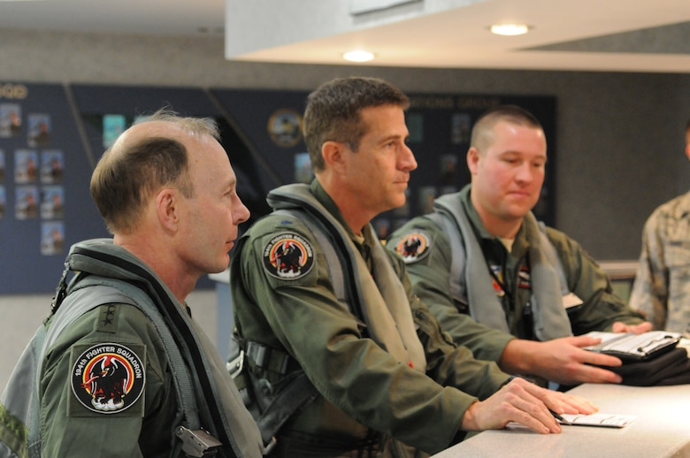 Gen. Charles H. Jacoby, Jr., Commander, North American Aerospace Defense Command and U.S. Northern Command, attends a pre-flight briefing at the 144th Operations Group, California Air National Guard, after completing an F-16 simulator orientation on January 5, 2012.  (U.S. Air Force photo by Master Sgt. David J. Loeffler)