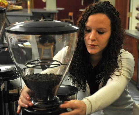 Ashlie Compton, 9th Force Support Squadron barista, prepares coffee beans for a customer at the Coyote Cafe Jan. 5, 2012. Compton said her goal is to go the extra mile to satisfy each customer and have them leave with a smile. (U.S. Air Force photo by Senior Airman Chuck Broadway/Released)