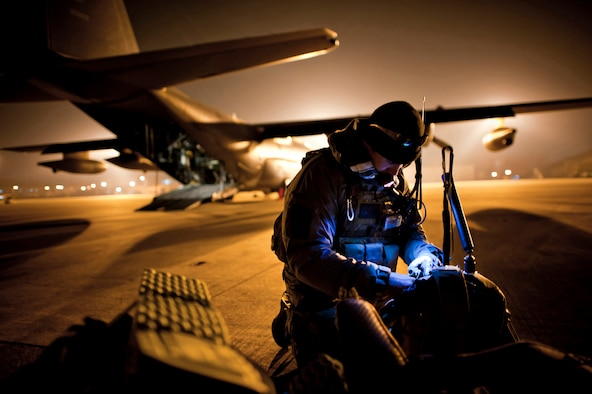 Tech. Sgt. Ray Decker prepares his rucksack prior to boarding an MC-130P Combat Shadow on March 16, 2011, at Yokota Air Base, Japan. Decker is from the 320th Special Tactics Squadron at Kadena AB, Japan. (U.S. Air Force photo/Staff Sgt. Samuel Morse)