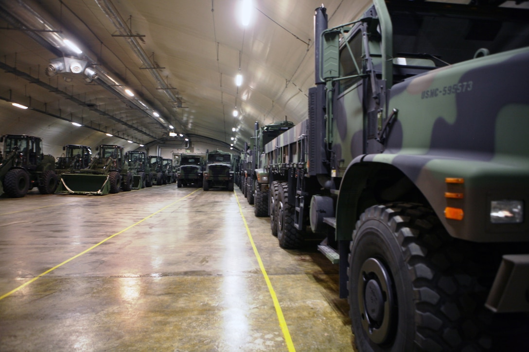 Rows of front loaders and 7-ton trucks sit, gassed up and ready to roll in one of the many corridors in the Frigard supply cave located on the Vaernes Garrison near Trondheim, Norway. This is one of seven caves that make up the Marine Corps Pre-positioning Program-Norway facility. All the caves total more than 900,000 sq. ft. of storage space, full of enough gear to outfit 13,000 Marines for up to 30 days.