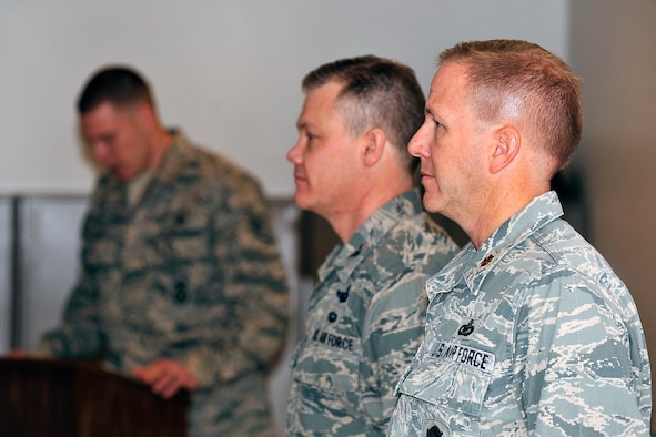 From right: Maj. Brent McGuire and Col. Tim Gibson stand attention during the reading of the citation for McGuire's Bronze Star Medal during a presentation ceremony at the Air Force Academy Jan. 6, 2012. McGuire, a reservist who works in a civilian capacity as a security forces trainer for the 10th Security Forces Squadron, received the medal for his actions while deployed to Kandahar Air Field, Afghanistan, as the 451st Expeditionary Security Forces Squadron commander. Gibson is the 10th Air Base Wing commander. (U.S. Air Force photo/Elizabeth Andrews)