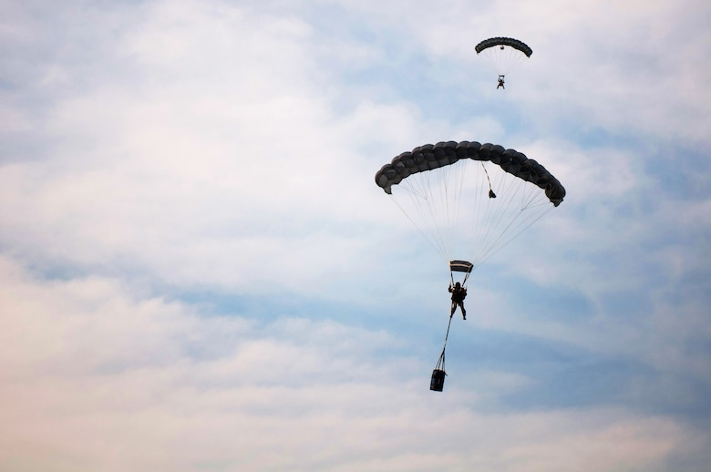 Two pararescuemen guide themselves to the drop zone at Camp Atterbury, Ind., June 14, 2011, during the second phase of a Precision Jumpmaster Course. The course was designed to provide instruction in the skills needed to rescue anyone on land or water, and condensed into three weeks the same amount of training that often takes years to complete. (U.S. Air Force photo by Master Sgt. Phil Speck)
