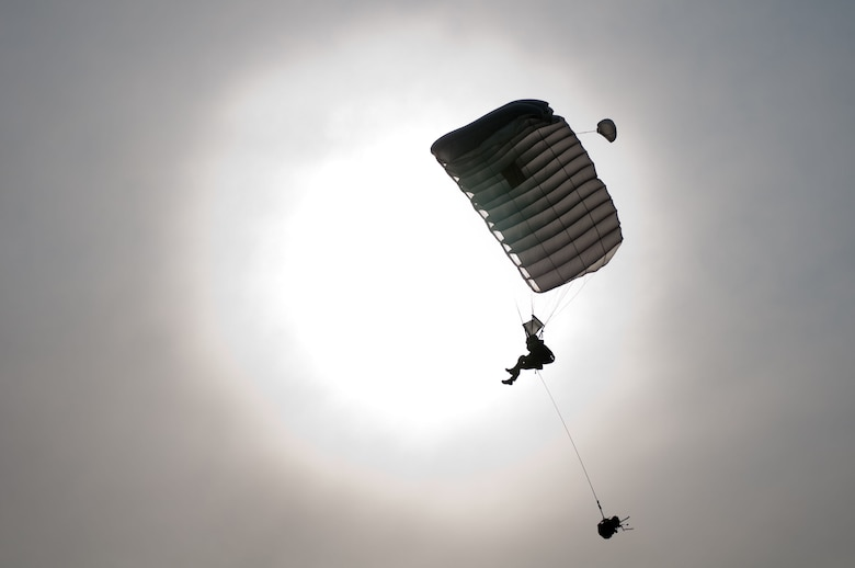 A pararescueman parachutes in to the drop zone at Camp Atterbury, Ind., June 14, 2011, during a Precision Jumpmaster Course taught by members of the Kentucky Air National Guard's 123rd Special Tactics Squadron. The three-week course also included ground training at the Kentucky Air Guard Base in Louisville, Ky., and water jump training in Selfridge, Mich. The course was unique in that active-duty forces were trained by members of the Air National Guard, organizers and participants said. (U.S. Air Force photo by Master Sgt. Phil Speck)