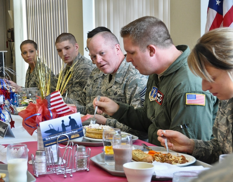 Command Chief Master Sgt. Christopher E. Muncy, command chief of the Air National Guard, prepares to answer questions posed by members of the 128th Air Refueling Wing's enlisted Airmen while having lunch at Sijan Hall in Milwaukee on January 08, 2012. Muncy was at the 128 ARW in part of tour of all the Air National Guard bases located in Wisconsin. USAF Photograph by Staff Sgt. Jeremy Wilson