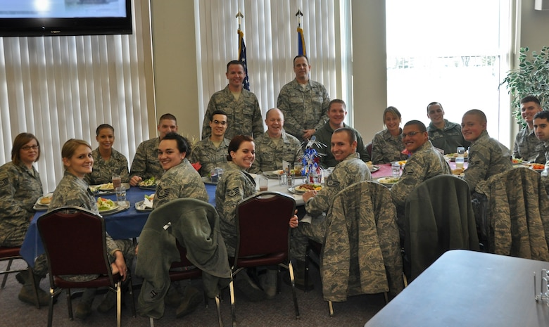 Command Chief Master Sgt. Christopher E. Muncy, command chief of the Air National Guard, prepares to eat lunch and converse with 15 members of the 128th Air Refueling Wing's enlisted Airmen in Milwaukee on January 08, 2012. Muncy was at the 128 ARW as part of a tour of all the Air National Guard bases located in Wisconsin. USAF Photograph by Staff Sgt. Jeremy Wilson