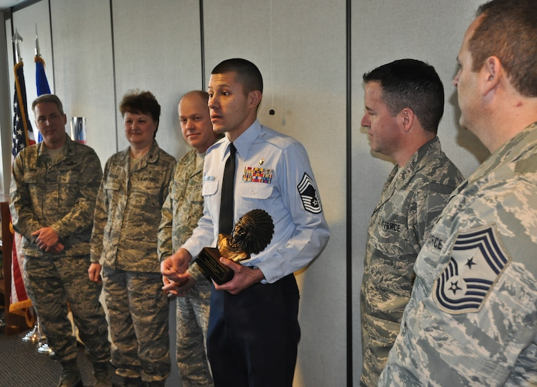 Chief Master Sgt. Antonio Marrero addresses his fellow Airmen of the 128th Air Refueling Wing's medical group after being presented with a chief's bust in Milwaukee on January 08, 2012. The Command Chief Master Sgt. of the Air National Guard, Christopher E.  Muncy, was at the 128 ARW, a stop in his tour of the Air National Guard bases located in Wisconsin, and presented the award to Marrero in recognition of his recent promotion to chief master sergeant. USAF Photograph by Staff Sgt. Jeremy Wilson