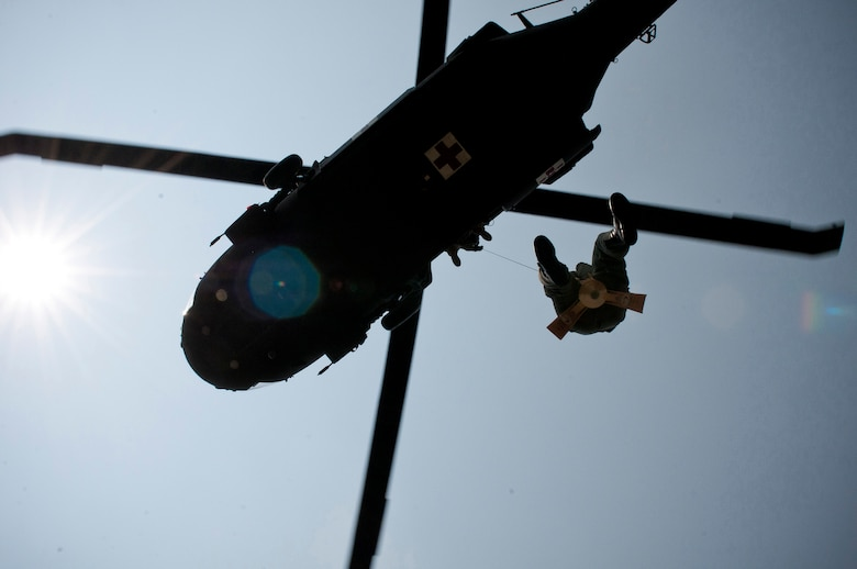 Medical evacuation troops from the Kentucky Army National Guard hoist Capt. Jennifer Nash, a Kentucky Air Guard C-130 pilot, into a UH-60 Blackhawk during land-survival training held June 9, 2011, in Taylorsville, Ky. Nash was participating in a two-day course designed to augment her survival skills. (U.S. Air Force photo by Senior Airman Maxwell Rechel)