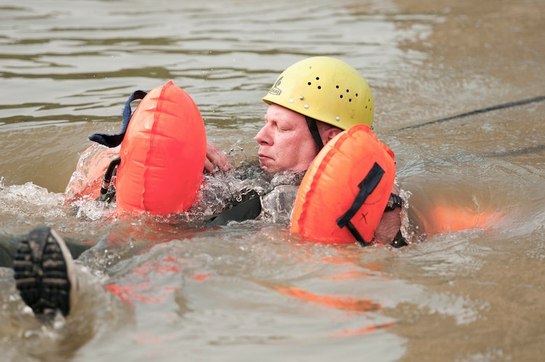 Master Sgt. Brian Bauer, a flight engineer with the Kentucky Air National Guard's 165th Airlift Squadron, releases his parachute canopy during a water-survival training exercise at Taylorsville Lake in Taylorsville, Ky., on June 9, 2011. The training is required of aircrew members every three years. (U.S. Air Force photo by Senior Airman Maxwell Rechel)